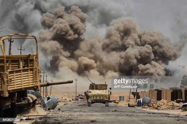 TOPSHOT Smoke billows as Iraqi forces advance towards AlAyadieh village the last remaining active front line near Tal Afar during an operation to...
