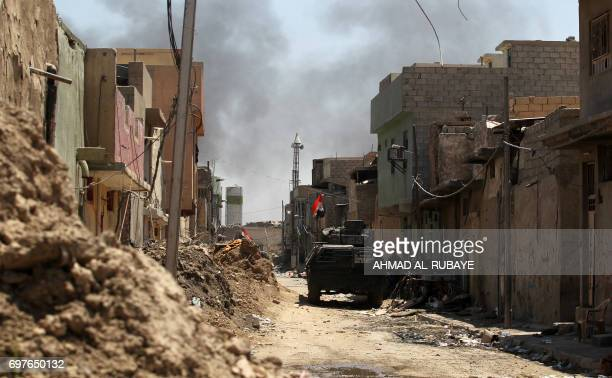 Smoke billows as Iraqi forces advance towards the Old City of Mosul on June 19 2017 during an ongoing offensive to retake the last district still...