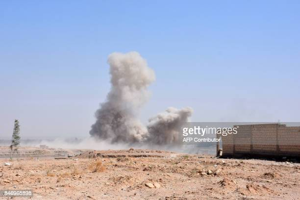 Smoke billows as Syrian progovernment forces advance in the Jamiyet alRuwad neighbourhood on the northern outskirts of Deir Ezzor on September 14...