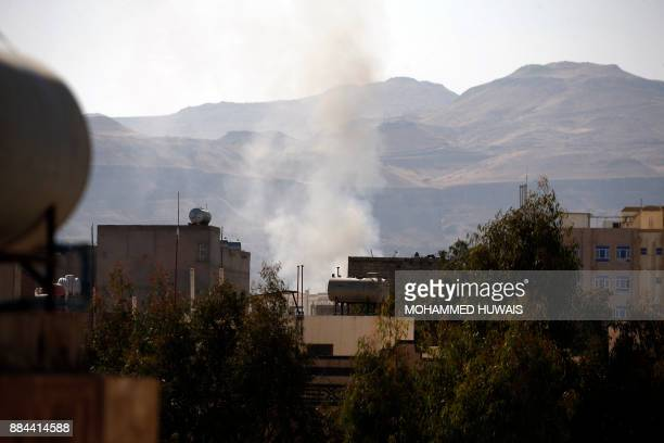 Smoke billows behind a building in the Yemeni capital Sanaa on December 2 during clashes with supporters of Yemeni expresident Ali Abdullah Saleh...