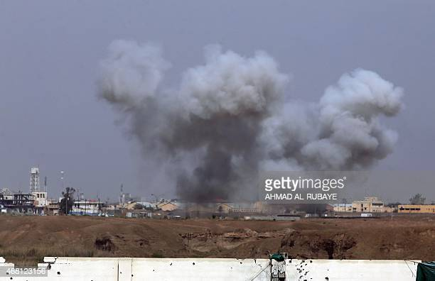 Smoke billows during a military operation by Iraqi forces and allied paramilitaries to retake the city of Tikrit from Islamic State group jihadists...