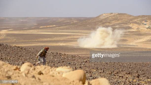 Smoke billows during clashes between forces loyal to Yemen's Saudi-backed government and Huthi rebel fighters in al-Jadaan area about 50 kilometres...