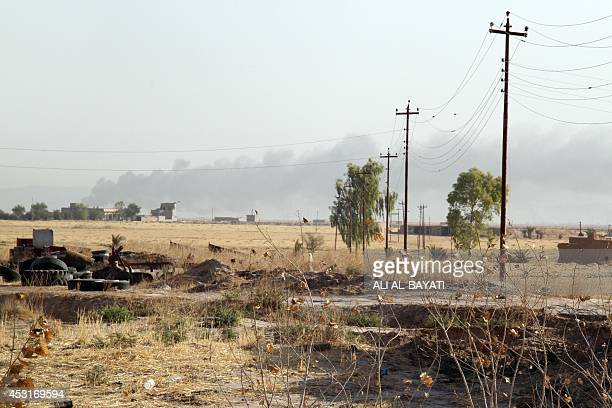 Smoke billows during fighting between Iraqi security forces, backed by Turkmen Shiite fighters, and Islamic State Sunni militants on August 4, 2014...