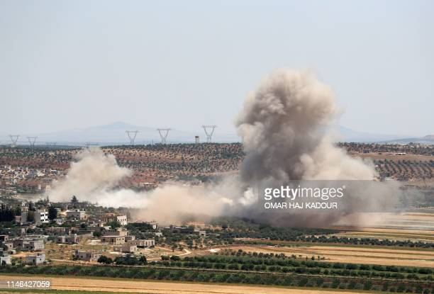 TOPSHOT Smoke billows during reported Syrian government forces' bombardments on the village of Sheikh Mustafa in the southern countryside of the...