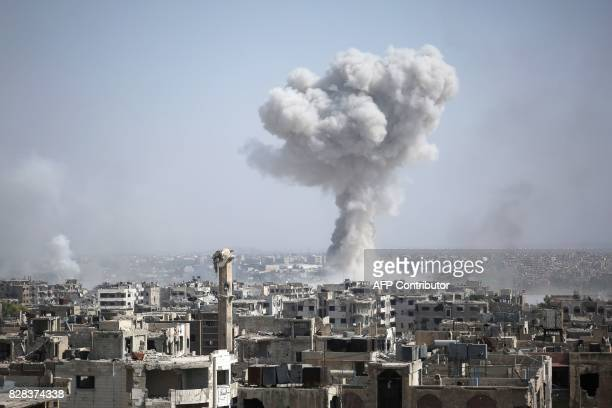 TOPSHOT Smoke billows following a reported air strike by Syrian government forces in the rebelheld parts of the Jobar district on the eastern...
