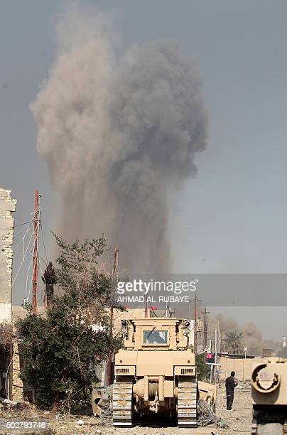 Smoke billows following a reported air strike by the USled coalition on December 29 2015 on the outskirts of Ramadi the capital of Iraq's Anbar...
