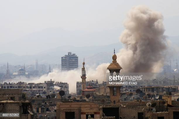 Smoke billows following a reported air strike in the rebelheld parts of the Jobar district on the eastern outskirts of the Syrian capital Damascus on...