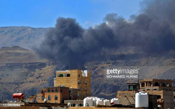 Smoke billows following a reported airstrike by the Saudi-led coalition in the Yemeni capital Sanaa, on November 27, 2020. - The Saudi-led military...