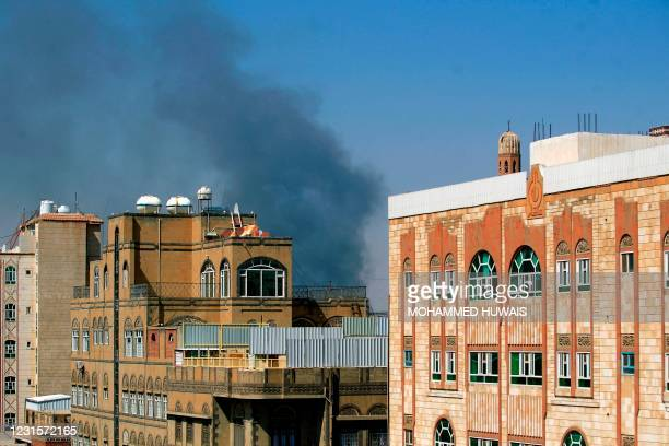 Smoke billows following a reported airstrike by the Saudi-led coalition in the Yemeni capital Sanaa, on March 7, 2021. - The Saudi-led military...