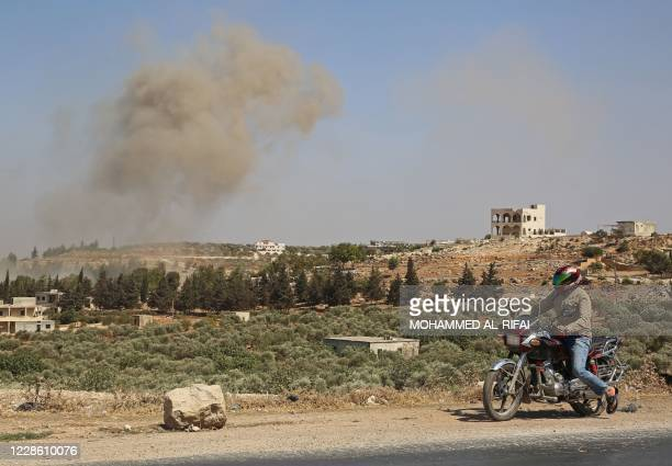 Smoke billows following a reported Russian airstrike on the western countryside of the mostly rebel-held Syrian province of Idlib, on September 20,...