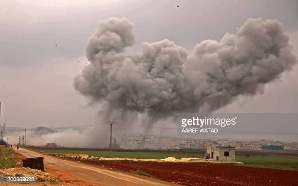 Smoke billows following a reported Syrian government air strike on the town of Atareb in the rebel-held western countryside of Syria's Aleppo...