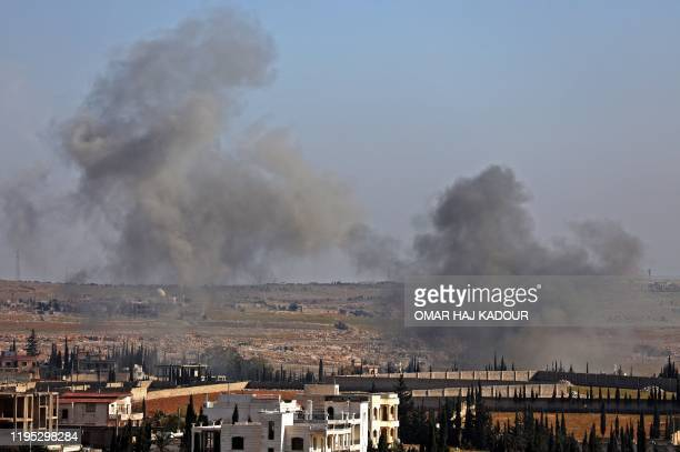 Smoke billows following a reported Syrian government airstrike in the town of Khan al-Assal in Syria's northwestern Aleppo province on January 22,...