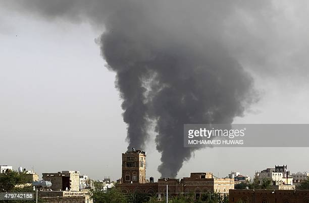 Smoke billows following airstrikes by the Saudiled coalition on a weapons depot at a military airport currently controlled by Yemeni Shiite Huthi...