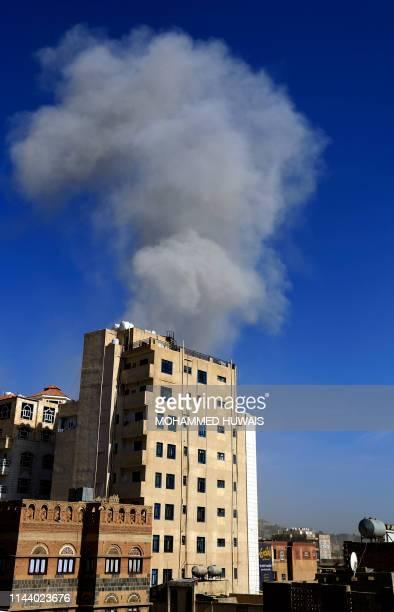Smoke billows following an air strike in the Yemeni capital Sanaa on May 16 2019 Warplanes struck the rebelheld Yemeni capital two days after the...