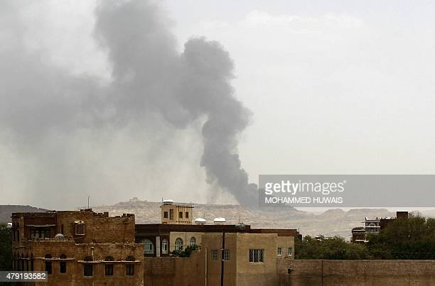 Smoke billows following an airstrike by the Saudiled coalition on a weapons depot currently controlled by Yemeni Shiite Huthi rebels on July 2 2015...