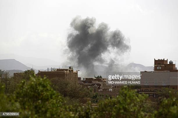 Smoke billows following an airstrike by the Saudiled coalition on a weapons depot currently controlled by Yemeni Shiite Huthi rebels on July 5 2015...