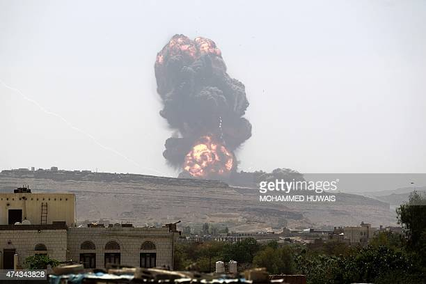 Smoke billows following an airstrike by the Saudiled coalition on an army arms depot now under Shiite Huthi rebel control on May 22 2015 east of the...