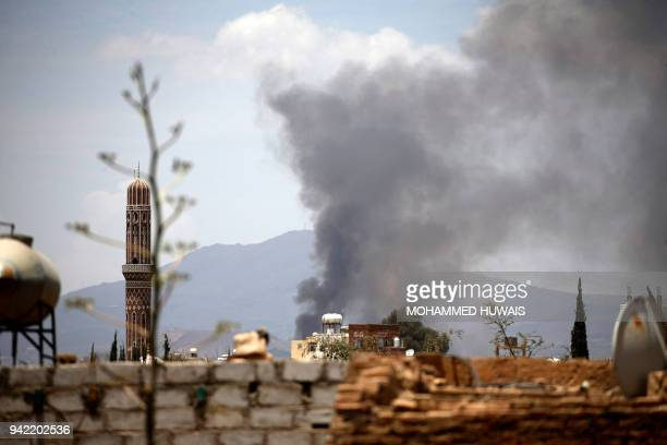 Smoke billows following an airstrike by the Saudiled coalition targeting the AlDailami air base in the capital Sanaa on April 5 2018 / AFP PHOTO /...