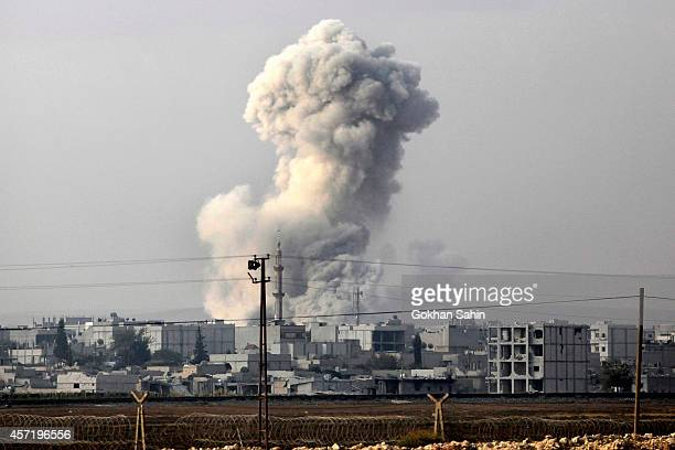Smoke billows following an airstrike by US-led coalition aircraft in Kobani, Syria, during fighting between Syrian Kurds and militants from Islamic...