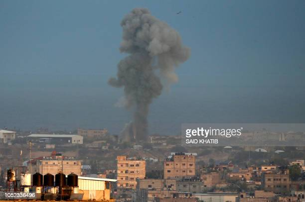 TOPSHOT Smoke billows following an Israeli air strike around the southern Gaza Strip city of Rafah on October 17 2018 Israel launched raids against...