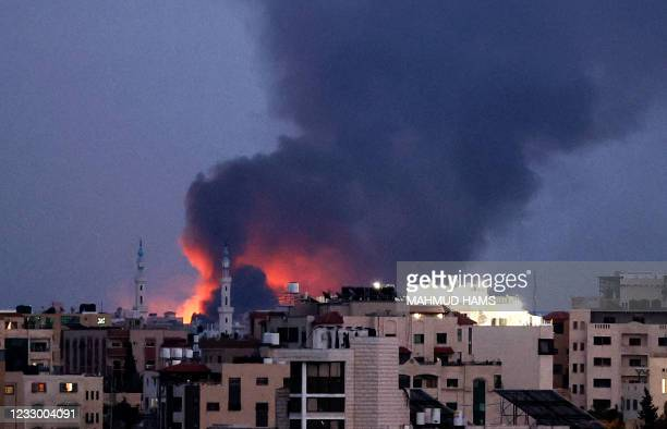 Smoke billows following an Israeli air strike on Gaza City, on May 20, 2021. - Diplomatic efforts gathered pace for a ceasefire on the 11th day of...