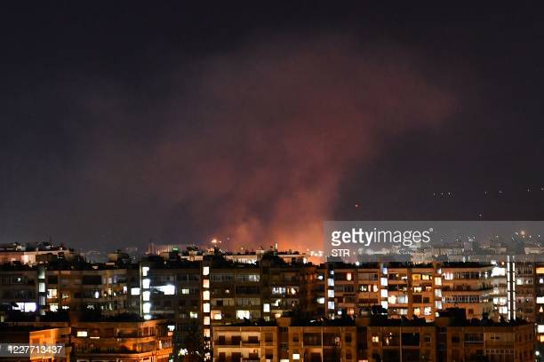 Smoke billows following an Israeli airstrike targeting south of the capital Damascus, on July 20, 2020. - Israeli strikes south of the Syrian capital...