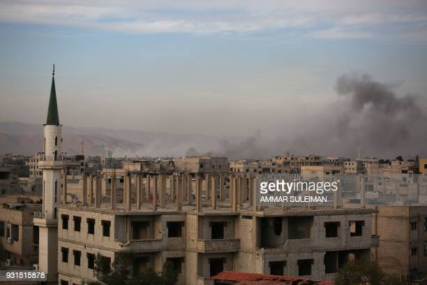 Smoke billows following government bombardment in Kafr Batna in the rebelheld enclave of Eastern Ghouta on March 13 2018 A day earlier the United...