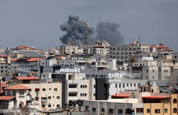 Smoke billows following Israeli airstrikes on Gaza City on May 12 amid the most intense Israeli-Palestinian hostilities in seven years. - Israel's...