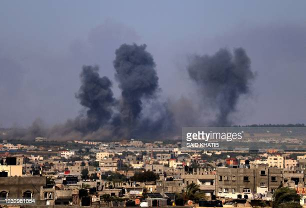Smoke billows following Israeli airstrikes on Rafah in the southern Gaza Strip on May 19, 2021.