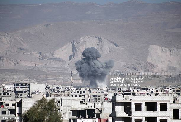Smoke billows following reported air strikes by Syrian government forces on the town of Arbin in the eastern Ghouta region a rebel stronghold east of...