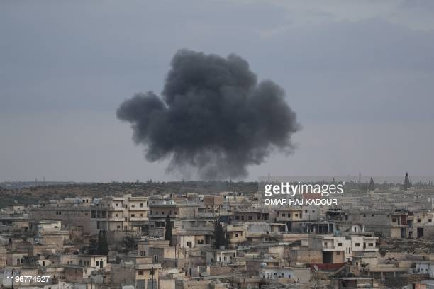 TOPSHOT Smoke billows following reported bombardment by Syrian regime forces on the town of Kafr Ruma on the outskirts of Maaret alNuman in the...