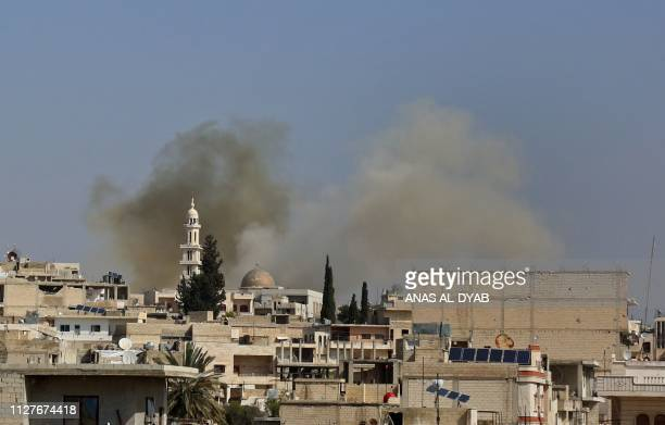 Smoke billows following reported shelling in the town of Khan Sheikhun in the southern countryside of the rebelheld Idlib province on February 26...