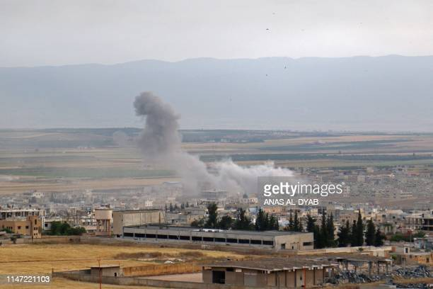 Smoke billows following reported Syrian government forces' bombardment on the town of Khan Sheikhun in the southern countryside of the jihadistheld...