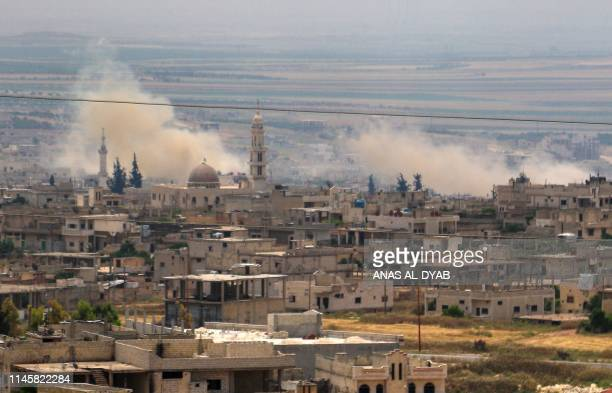 Smoke billows following reported Syrian government forces' bombardments in the southern countryside of the largely jihadistcontrolled region of Idlib...
