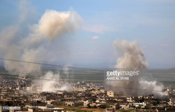 Smoke billows following shelling in Khan Sheykun in Syria's jihadistheld Idlib province on May 10 2019 Violence in the northwestern Syrian region of...