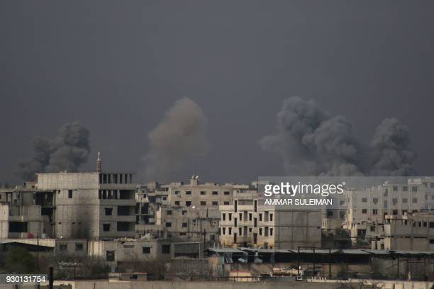 Smoke billows following Syrian government bombardment on the rebelcontrolled town of Misraba in the eastern Ghouta region on the outskirts of the...