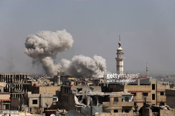 TOPSHOT Smoke billows following Syrian government bombardment on the rebelcontrolled town of Kafr Batna in the besieged Eastern Ghouta region on the...