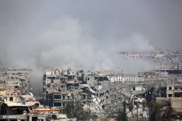 TOPSHOT Smoke billows following Syrian government bombardment on the rebelheld besieged town of Harasta in the Eastern Ghouta region on the outskirts...
