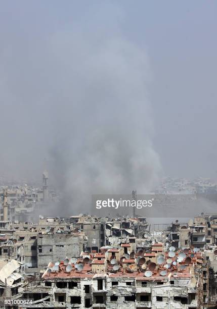 Smoke billows following Syrian government bombardment on the rebelheld besieged town of Harasta in the Eastern Ghouta region on the outskirts of...