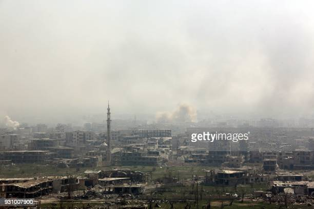 Smoke billows following Syrian government bombardment on the rebelheld besieged town of Arbin in the Eastern Ghouta region on the outskirts of...