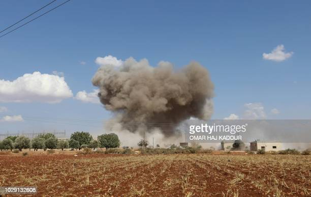 TOPSHOT Smoke billows following Syrian government forces' bombardment around the village of alMuntar on the southern edges of the rebelheld Idlib...