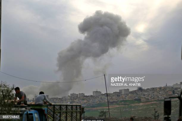 TOPSHOT Smoke billows following the explosion in the northwestern Syrian city of Afrin after SyrianArab Turkish backed fighters took control of the...