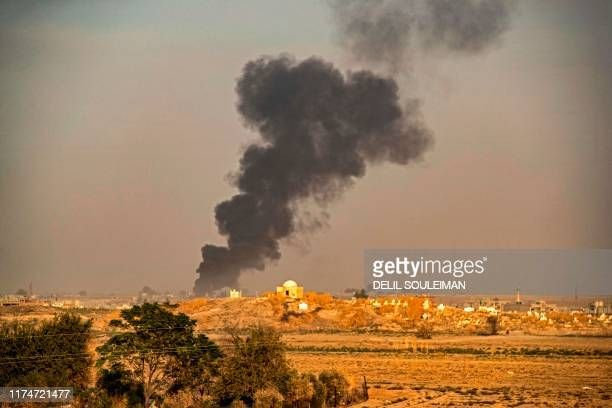 TOPSHOT Smoke billows following Turkish bombardment on Syria's northeastern town of Ras alAin in the Hasakeh province along the Turkish border on...