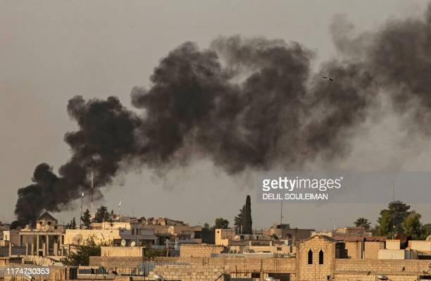 Smoke billows following Turkish bombardment on Syria's northeastern town of Ras alAin in the Hasakeh province along the Turkish border on October 9...