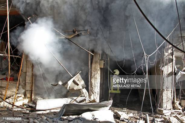Smoke billows from a building following a reported bombardment by pro-Syrian government forces in the town of Maaret al-Numan in Syria's Idlib...