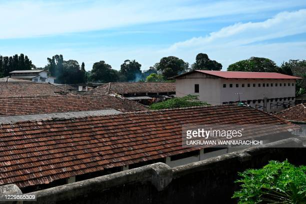 Smoke billows from a building inside Mahara prison on the outskirts of Colombo on November 30, 2020 a day after a prison riot over the surge of...