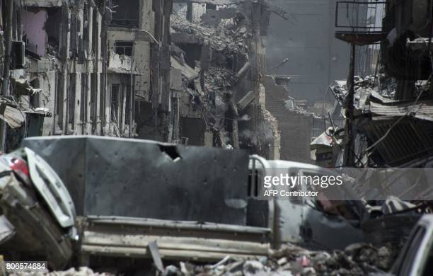 Smoke billows from a building where Islamic State group fighters are taking shelter as Iraqi forces fight them, in the Old City of Mosul on July 3,...