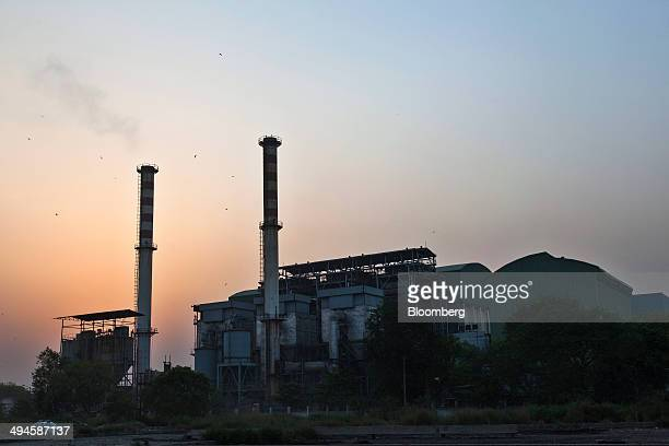 Smoke billows from a chimney stack at the Timarpur Okhla Waste Management Co wastetoenergy incinerator plant operated by Jindal Saw Ltd in the...