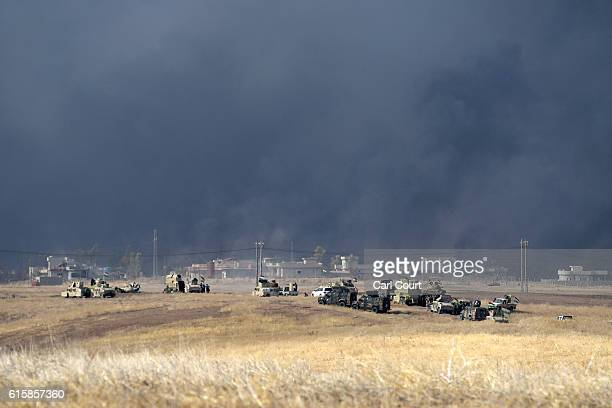 Smoke billows from a combined aircraft artillery and ground attack as Kurdish peshmerga forces battle to recapture the village of Tiskharab from ISIS...