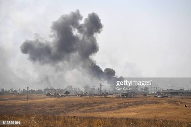 Smoke billows from a combined aircraft artillery and ground attack to recapture the village of Tiskharab from ISIS on October 20 2016 near Mosul Iraq...